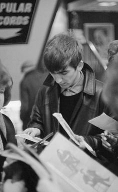 George Harrison with fans at the Epstein family's NEMS music store, Liverpool, February 1, 1963
