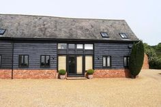 reclaimed brick and black timber Barn Windows, Steel Windows, Barn Conversion Exterior, Barn Conversions, Weatherboard Exterior, Composite Cladding, Dream House Exterior, House Exteriors, House Cladding
