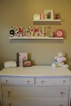 mismatched pattern baby name letters shelved.