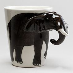 Elephant Mug.  I would be afraid to use this guy as a mug.  I would use him as a vase.