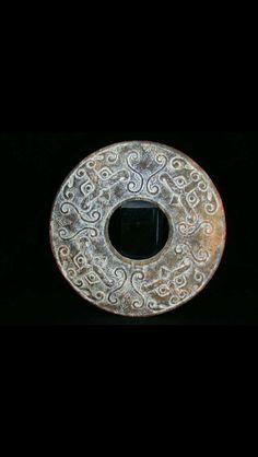 Zhou Dynasty jade bi with four masks