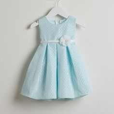 This dress makes a great choice for the spring/summer season for your baby girl from Sweet Kids. The blue dress features a polka dot Jacquard pattern and has a jeweled flower attached at the waistline. Add this to her wardrobe for a touch of cute flair.
