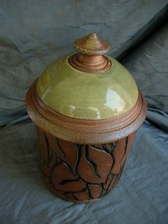 Ceramic Wood Fired Jar with Hand-Carved Leaves in Wintergreen. Sally Anne Stahl at www.clayshapergallery.com