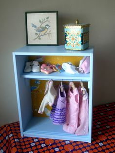 """plans to build a doll clothing """"closet"""";  could use a basic bookshelf without one of the shelves and a tension rod."""
