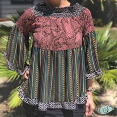 Chain ruffled bell sleeve blouse. Beautiful look with three tiers. Free flowing wide bell sleeves Mauve snake print and chain fabric makes this a gorgeous combination. Order