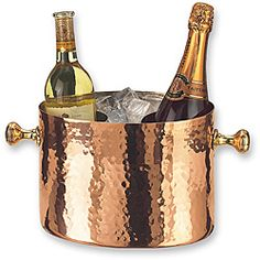 @Overstock - Ideal for poolside parties and outdoor dining, this attractive bottle chiller keeps your wine cold in style. The versatile chiller doubles as an ice bucket, but you can also use it as a decorative way to store firewood, magazines, and more.http://www.overstock.com/Home-Garden/Copper-Double-Bottle-Chiller-with-Aluminum-Insert/3864813/product.html?CID=214117 $95.24