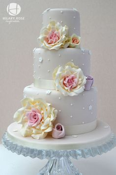 3 tier wedding cake with large gum paste roses. This cake is based on a Cotton and Crumbs  design, I was lucky enough to attend one of her masterclasses.