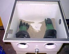 Sandblasting Cabinet by Bob Hines -- Homemade sandblasting cabinet constructed from a laundry tub, PVC, hose clamps, conduit, safety glass, and rubber gloves. http://www.homemadetools.net/homemade-sandblasting-cabinet-20