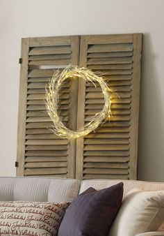 DIY modern and simple holiday decor on a budget. Use dried vines, spraypaint and lights for this minimalist wreath.