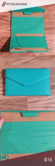 TGIF SALE  Turquoise Travel Wallet NWOT Super cute turquoise travel wallet  Never been used - tags removed.  Trifold opens up.  Lots of pockets and zippers for all your travel needs.  Cute trendy color.   Smoke and pet free home. Same day shipping! Bundle for a private offer ! Happy poshing !  Bags Wallets