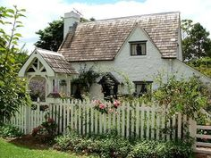A cottage with a picket fence.