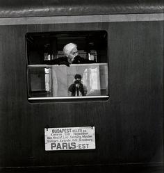 Elliott Erwitt. HUNGARY. Budapest. 1964. Photographer Elliott Erwitt in the glass.
