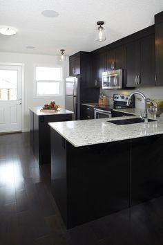 Dark cabinets, sleek quartz countertop - very sophisticated. #zeninbalance