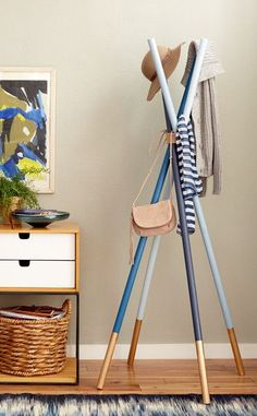 A paint dipped coat rack adds storage and whimsy to your entry.