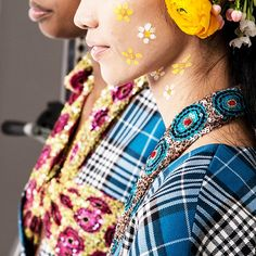 """Backstage at Tata Naka, AW17 London Fashion Week where inspiration was """"power of the flower."""" Looks were created with MAC Acrylic Paint in Primary Yellow and Pure White."""