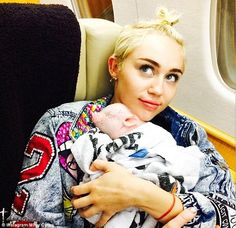 Love: The singer tapped into her maternal side as she coddled the young pig in a photo shared on Sunday