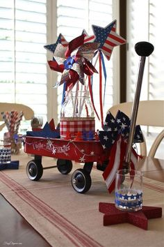 Wagon Patriotic Table Centerpiece I am so doing something similar with my mini red wagon!I am so doing something similar with my mini red wagon! Fourth Of July Decor, 4th Of July Celebration, 4th Of July Decorations, 4th Of July Party, July 4th, Birthday Decorations, Church Decorations, Diy Decoration, Patriotic Crafts