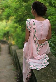 PRODUCT DESCRIPTION: Featuring a balmy baby pink pure chiffon saree with beautifully embroidered satin pink rose vines along the edges. Blouse Back Neck Designs, Fancy Blouse Designs, Sari Blouse Designs, Saree Blouse Patterns, Designer Blouse Patterns, Bridal Blouse Designs, Indian Dresses, Indian Outfits, Plain Saree