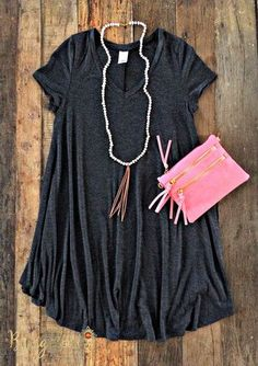 grey dress with a pink purse