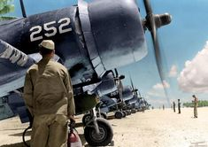 """F4U-1 Corsair #252 (possibly that of 1/Lt. William 'Bill"""" Boshart) VMF 224, Marine Corps 4th Marines Aircraft Wing, Majuro Airstrip, Marshall Islands. Planes being readied for fighter patrol due to radar picking up Japanese bombers headed for the Palau Island group, Peleliu, September 19th 1944."""