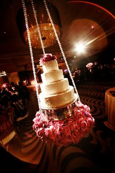 Holy Molers!!! hanging wedding cake!! beautiful!! Until some kid (grown or not) decides he can't resist a push.