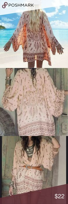 New boutique! Sheer BOHO kimono! New in package, from factory without tags. Perfect for this summer to throw over a tank or use as a swim suit cover up. It's a peachy-pink color the designs are in a brown color. Very beautiful! Sweaters Cardigans