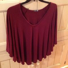 """❤️ Pretty, billowy top-NWOT! Maroon v-neck top w/fluttery sleeves that fall below your elbow, thick micro modal/spandex blend, size L, 25""""L from back neckline to hem, 20""""L from v neck to front hem, never worn, NWOT! Made in USA! Would be perfect for a Valentine's Day outing! City Lights Tops"""