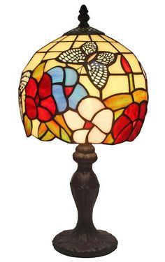 An elegant pattern floral from this classic Amora Lighting table lamp that instantly brings refinement to any room. This colorful Amora Lighting Tiffany-style table lamp features a pull chain and 156 Tiffany Style Table Lamps, Tiffany Lamps, Custom Stained Glass, Stained Glass Flowers, Lamp Shade Store, Butterfly Design, Handmade Furniture, Lighting, Butterflies