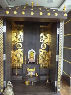 Pooja Room Design: this is gorgeous, of course; but personally, all the dark color (natural wood color?) is not to my taste. It feels too tamasic...