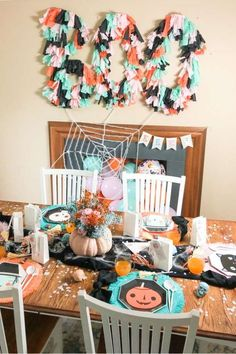 Feast your eyes on this chic colorful kids Halloween party! The table settings are awesome!Love the spooky plates!  See more party ideas and share yours at CatchMyParty.com #catchmyparty #partyideas #halloween #halloweenparty #bohohalloweenparty #kidshalloweenparty #boo
