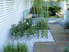Garden walk way design from the basement front garden entrance around the side to the back garden. Simple, elegant and totally understated.