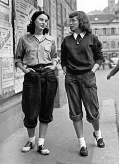 London, 1950. Love the Teddy Girl style. Can replicate with brogues + socks, pants (e.g. checked Cue pants or crop Dotti navy trousers), button-down shirt. No / natural makeup, plain hair or messy high bun or loose braided bun. Not sure about the rolled trousers - do they make this outfit?