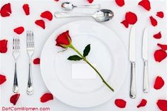 Valentine's Day Table Decoration and Place Setting with Roses and Rose Petals