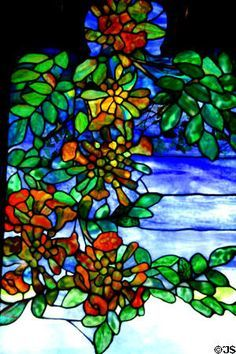 Detail of Louis Comfort Tiffany's Rochroane Castle stained glass window at Corning Museum of Glass.