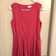 Red polka dot dress Like new, only worn a couple of times. The dress is fitted around the ribcage and waist. Manteau Dresses Midi