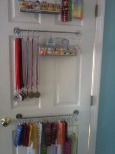 Another idea for displaying medals that I came across - but they would clank every time you open the door, so perhaps a stationary surface would be better.Maybe we could hang your scarves inside your closet door or on the closet wall inside Award Ribbon Display, Award Display, Display Ideas, John Johnson, Trophy Display, Getting Organized, Home Organization, Girl Room, Room Decor
