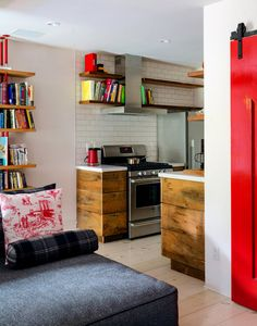 the-design-nerd:  Colorful kitchen/living area at Mike D's (of the Beastie Boys) Brooklyn, NY townhome; source