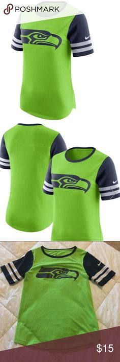 Nike Seahawks Neon Green Gear Up Performance Top EUC, size small. Get ready to prove your dedication to the Seattle Seahawks every time you wear this awesome Nike Gear Up Modern Fan Dri-FIT T-shirt. Its prominent Seattle Seahawks colors and graphics will let everyone know that you're the #1 fan.  Tagless, 65% Polyester/35% Cotton. Rib-knit collar, contrast color collar and sleeves, crewneck, short sleeve, screen print graphics.  Bundle and save!! Nike Tops Tees - Short Sleeve