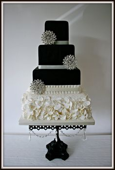 Monochrome Chic - This design is heavily based on a gorgeous cake by Heavenly Angel Cakes who made a such a lovely sophisticated cake I just had to make something similar and I hope i did her design justice with this one. Ruffles rather than flowers on the bottom tier of this one and a few diamante brooches to finish off.