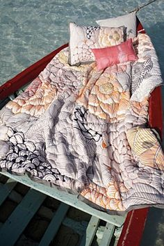 quilt in an old boat.  need this in my life