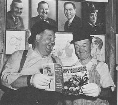 Stan Laurel and Oliver Hardy reading a Spy Smasher comic book.