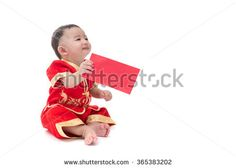 Cute Asian baby in traditional Chinese suit with red pocket, Isolated on white background, Chinese New Year Concept