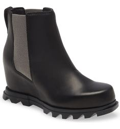 Free shipping and returns on Joan of Arctic III Waterproof Wedge Bootie at Nordstrom.com. A lug sole with grippy scalloped tread offers sure-footed traction as you take on inclement weather in this chic waterproof bootie. A Chelsea-inspired silhouette with a slimmer, foot-flattering shape adds to the boot's timeless appeal, while a subtle hidden wedge gives your look just-right height.