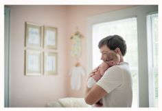 Jordan Burch Photography: Home Style Newborn Shoot. Dad and baby in nursery.  Simple but pure.
