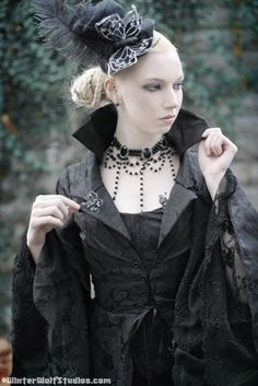 This coat is brilliant, and is filling me with longing to go out and buy tons of black brocade.