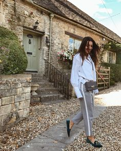 White oversized shirt and grey trousers