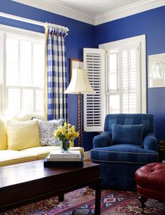 Suellen Gregory: checked curtains are fun in bold blue room with red and soft yellow accents
