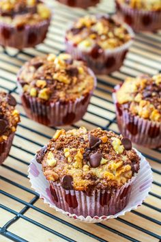 Super-moist and flavorful banana chocolate chip muffins stuffed and topped with cinnamon streusel.