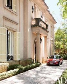 The couple's Mini Cooper at the neoclassical-style portico   archdigest.com