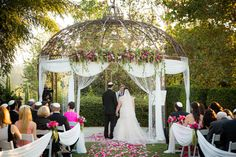 The gazebo at Woodland Hills Country Club is softened with some chiffon and crystal garlands for a beautiful wedding ceremony.